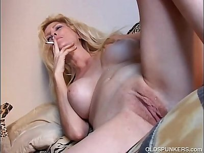 Beautiful blonde MILF enjoys a smoke break